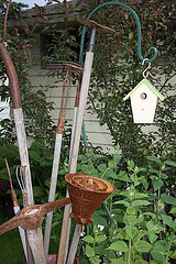 Vintage garden tools and birdhouse image