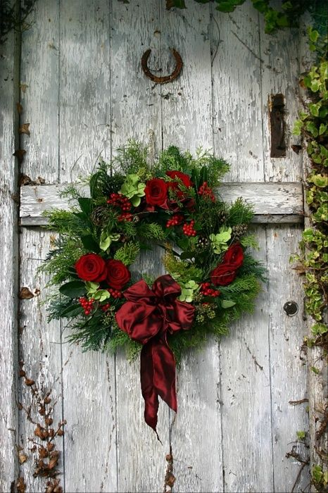 Christmas wreath on a rustic barn door